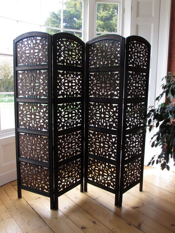 Indian carved wooden screen with 4 panels with a leafy design
