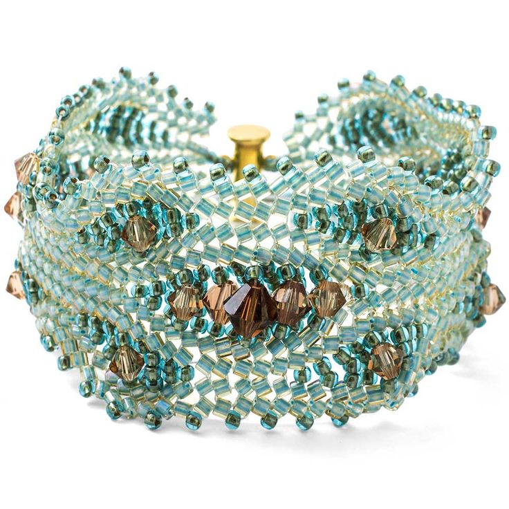 Shimmering with crystal bicones by Swarovski Elements, the Peacock Bracelet is a fabulous way to blend your favorite crystal colors and build your herringbone skills. The  Peacock Bracelet Kit by Fusion Beads® comes with fully illustrated instructions.