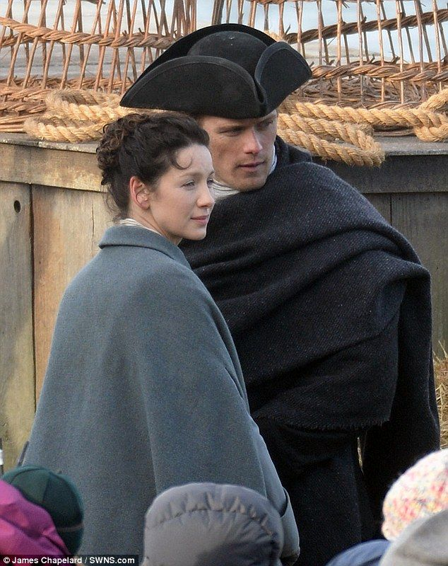 The happy couple? Sam Heughan and Caitriona Balfe no doubt further added to rumours as they pulled off further convincing portrayals as husband and wife while filming time travel series Outlander at Scotland's Dunure Harbour on Monday
