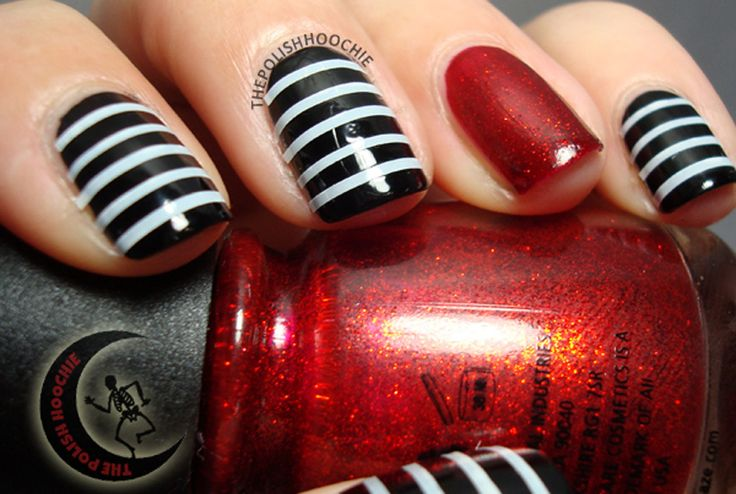 These mani's dark colors give off a cool fall vibe. No need to strip this polish once October 31 has come and gone.
