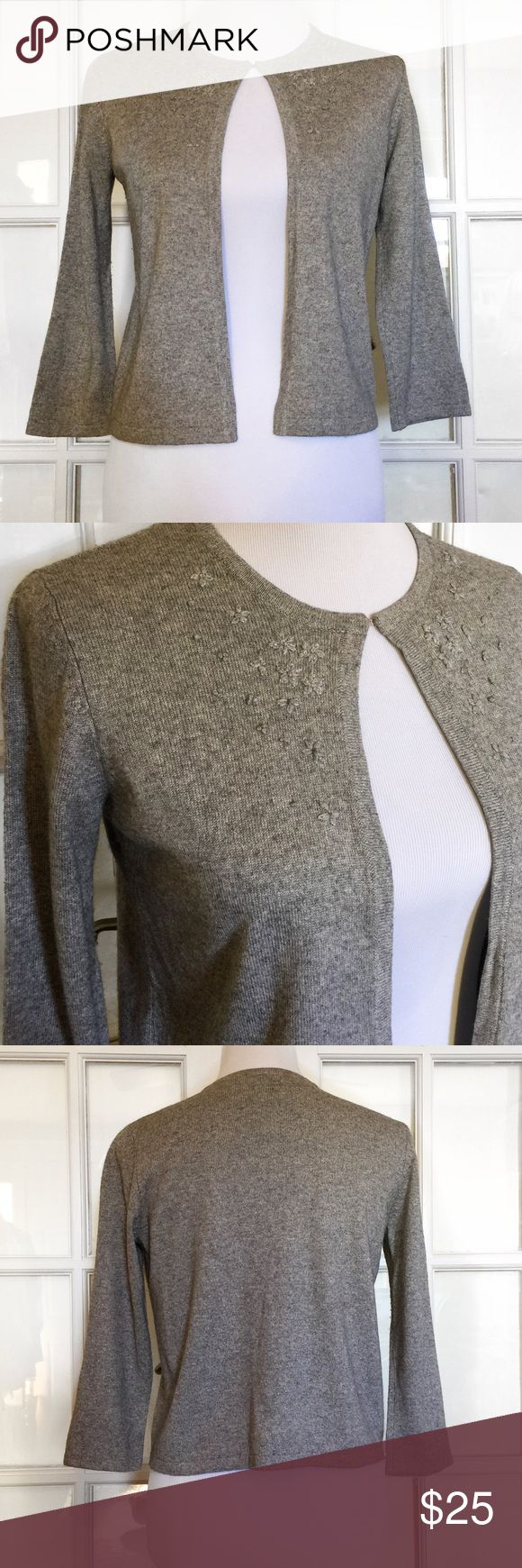 The Limited Silk/Cashmere Blend Grey Shrug Lovely little cropped Cardigan features delicately stitched flowers, neck clasp closure, 3/4 Sleeve and cozily soft 85% Silk, 15% Cashmere Blend. Dry Clean The Limited Sweaters Shrugs & Ponchos