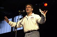 Al Franken entertaining troops at Ramstein Air Base in December 2000. From Wikipedia.
