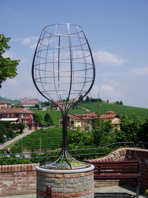 Barolo, Italy -unique wine sculpture over looking vineyards.