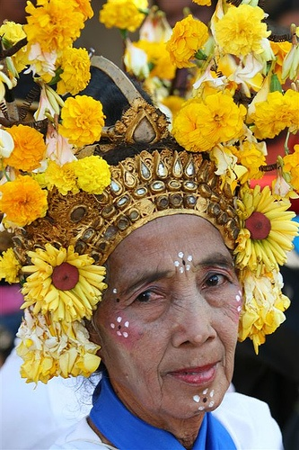 Old woman with a traditional flower headdress, Lombok, Indonesia