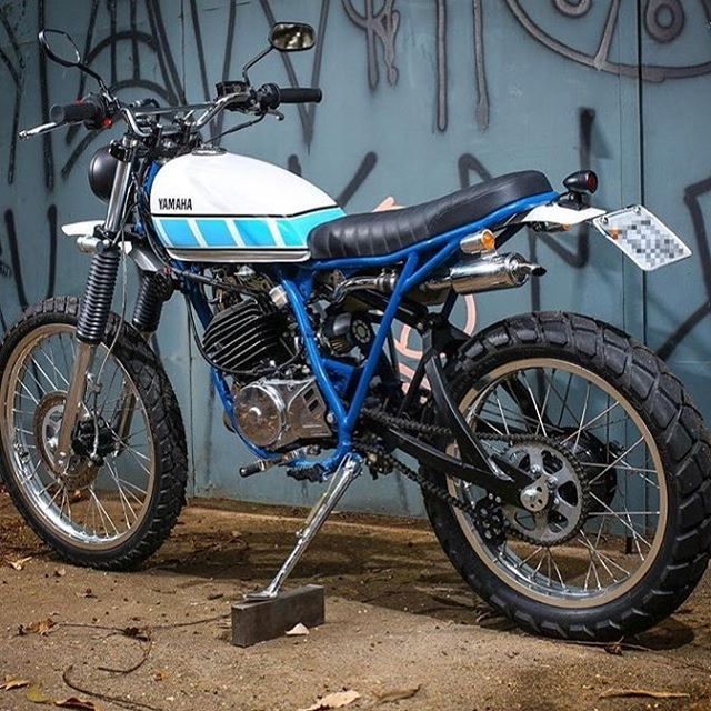 "Loving this bundle of fun. 1990 Yamaha DT 180cc named ""DTreta"" built by @benta.handmade.machines. Thanks for sharing! @photoandroad #dropmoto #streettracker #builtnotbought #vintagemotorcycle #dt190 #yamaha #yamahadt"