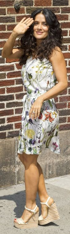 Who made Salma Hayek's floral dress and stripe wedge sandals that she wore in New York on July 10, 2013?