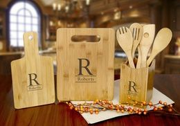 Groupon - Custom Bamboo Serving Board, Cutting Board, Utensil Holder, or All Three from Monogram Online (Up to 80% Off). Groupon deal price: $7.99