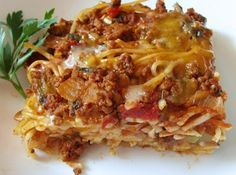 Baked Spaghetti; think I might try with chicken.  It looks like something I can do ahead of time and pop in the oven.