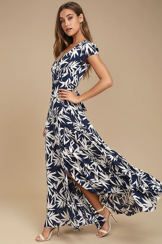 Travel to the Mediterranean in the Amuse Society Provence Navy Blue Print Wrap Maxi Dress! Navy blue, black, and white, leaf print woven fabric shapes a surplice bodice with short sleeves. Wrapping maxi skirt features a tying waist sash and front slit.