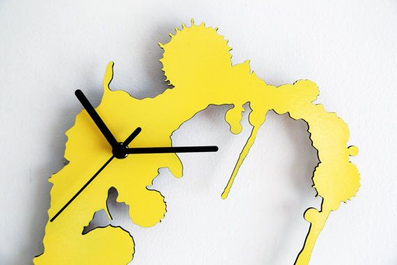 Hey, I found this really awesome Etsy listing at https://www.etsy.com/listing/151046631/ink-splatter-modern-wall-clock-yellow