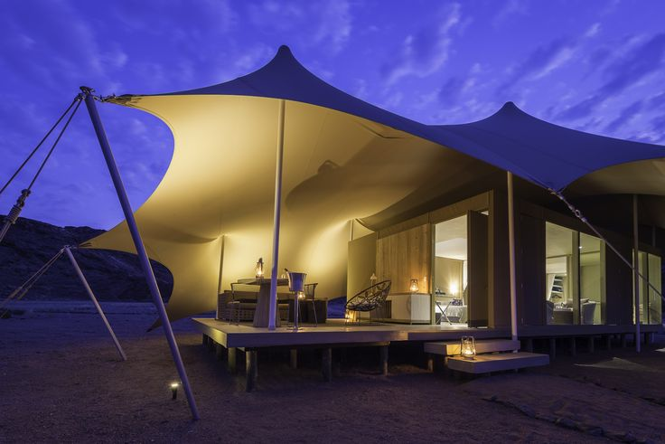 Hoanib Skeleton Coast - Drop. Dead. Gorgeous. Only accessible by light aircraft and featuring just 8 suites, the Hoanib Skeleton Coast Camp is African exclusivity at its finest. This open-aired property creates the simultaneous sensation of indoor luxury and outdoor splendor. Relax from your stylish bedroom and shaded outdoor deck and revel in the scenic beauty