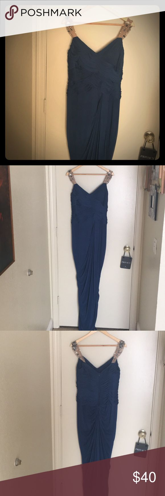 Navy blue Adrianna Papell Evening Gown size 10 Worn once, this navy gown with jeweled sleeves is absolutely a stunner! It is a size 10, and hugs curves in all the right place! Adrianna Papell Dresses