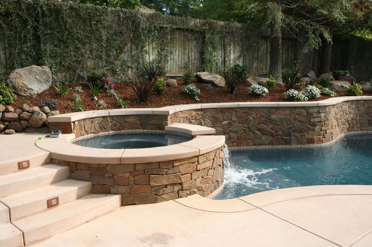Pool and Spa with Rock Veneer Wall