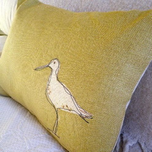 hand printed and stitched soft gold wading bird cushion