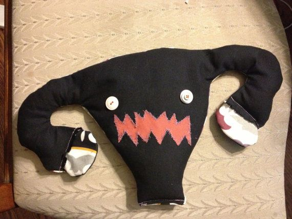 Angry uterus heating pad. Keep your uterus warm to alleviate cramps, or use a cat.