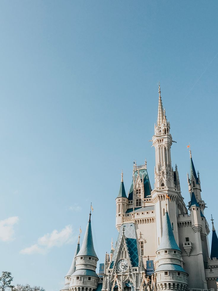 cinderella s castle during clear blue sky blue aesthetic