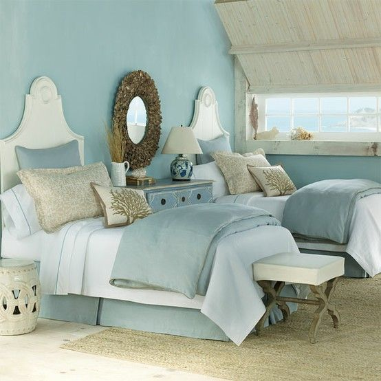 Gorgeous turquoise walls look fabulous in this bedroom. Twin beds never looked so lovely!