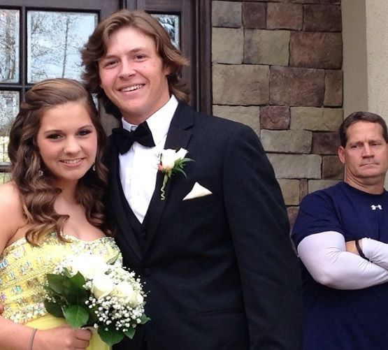 Gene Chizik does not look happy with his daughter's prom date