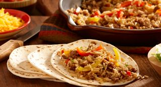 Sausage and Peppers Dirty Rice Soft Tacos: Make Cajun-style soft tacos with a filling of Zatarain's® Dirty Rice Mix, pork sausage and bell peppers. Serve with assorted toppings so your guests can personalize their taco filling.