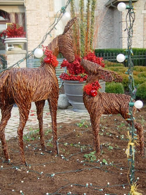 Pretty natural deer decor adds a woodsy touch to your garden at Christmas.