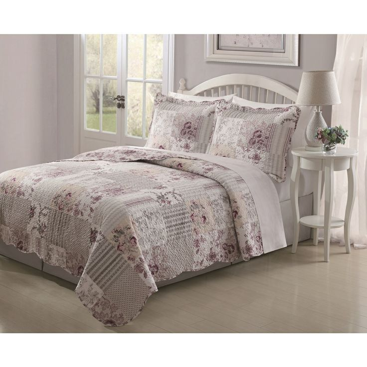 Patchwork quilt, white furniture, light gray walls for a calming bedroom