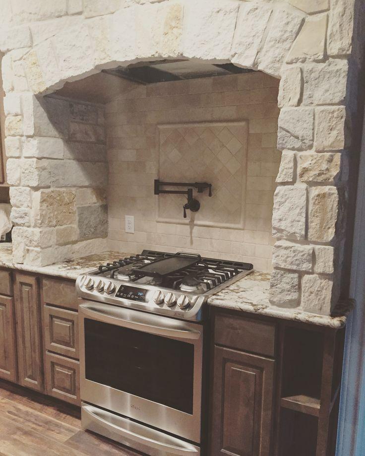 Gas range, moen pot filler, cook book shelves and stone