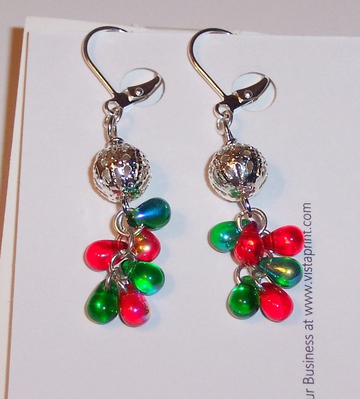 Christmasy earrings with green and red glass teardrops (AB on one side of each bead) dangling from silver filigree beads. $12.00
