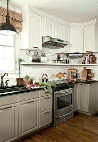 Grey/green and white. Black counters. Moving standard cupboards up and adding shelving below.