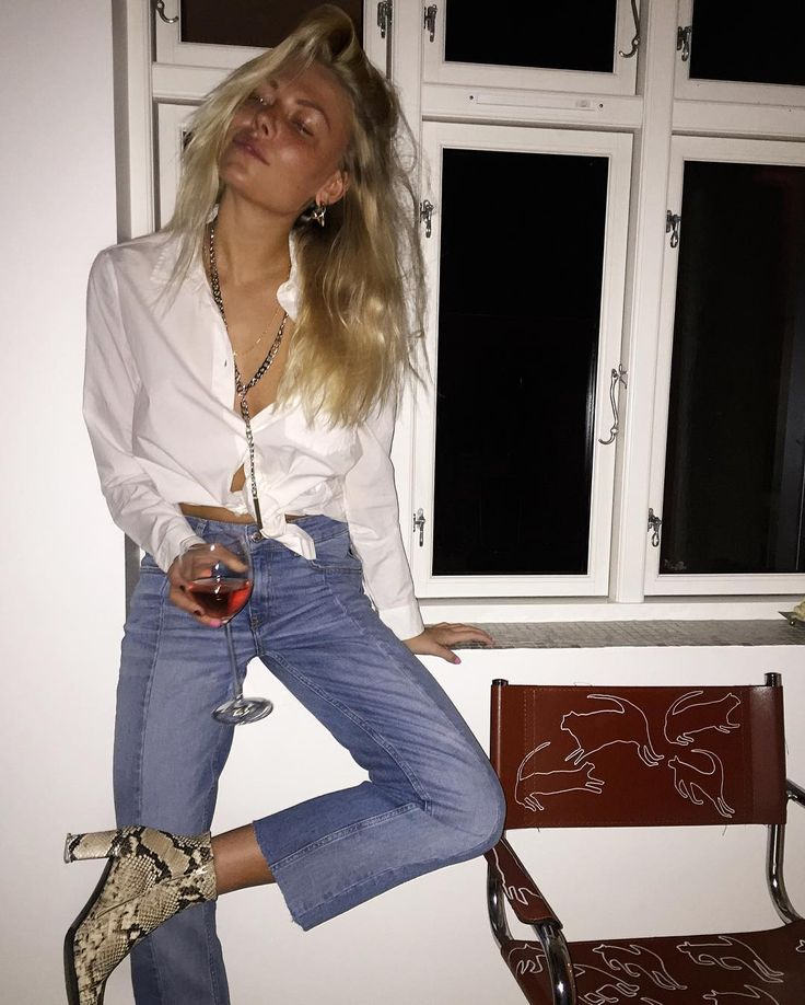 White blouse, vintage mom jeans, and ankle boots.