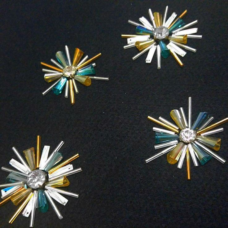 Beaded starbursts • would look lovely on a plain fine knit cardigan or jumper