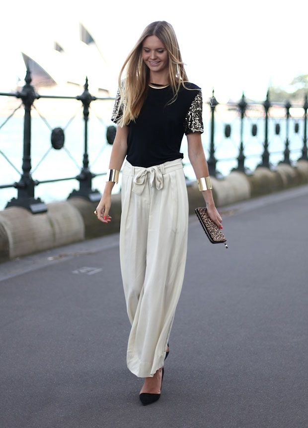To my mind, the draping, relaxed charm of palazzo pants and the boyish graces of the 1920s go hand in hand. But those wide-legged things can also be given a more modern definition. With solid gold cuffs and a sequinned sleeve tee, these Zimmermann pants are just as easily the modern girl's choice for evening wear.