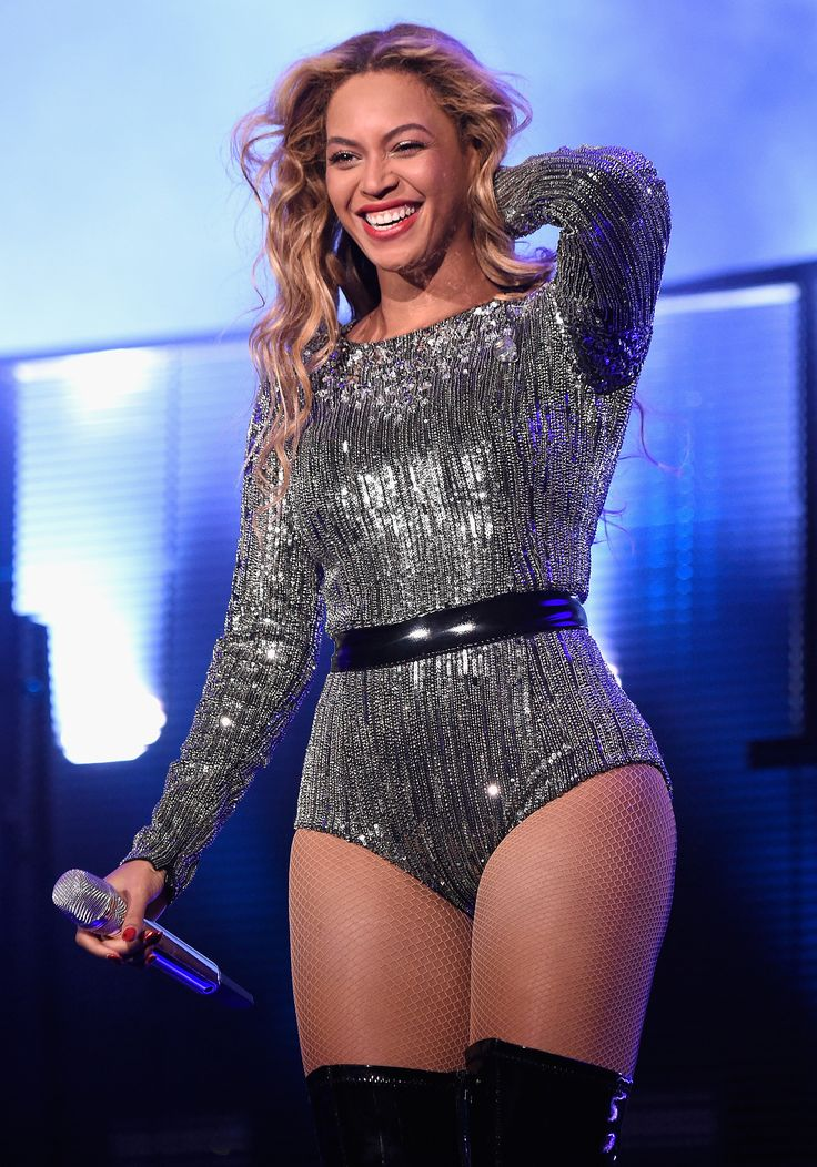 A lesson to learn from Beyonce: Don't apologize for piling on the shine. She accented her brilliant silver bodysuit with shiny black patent add-ons.