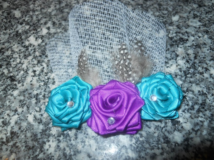 Headband with Purple and Teal rolled roses, tulle and feathers.    Price: $12  Shipping: Send Message    http://www.facebook.com/CandysCoutureCanada    Handmade by Candy's Creations.