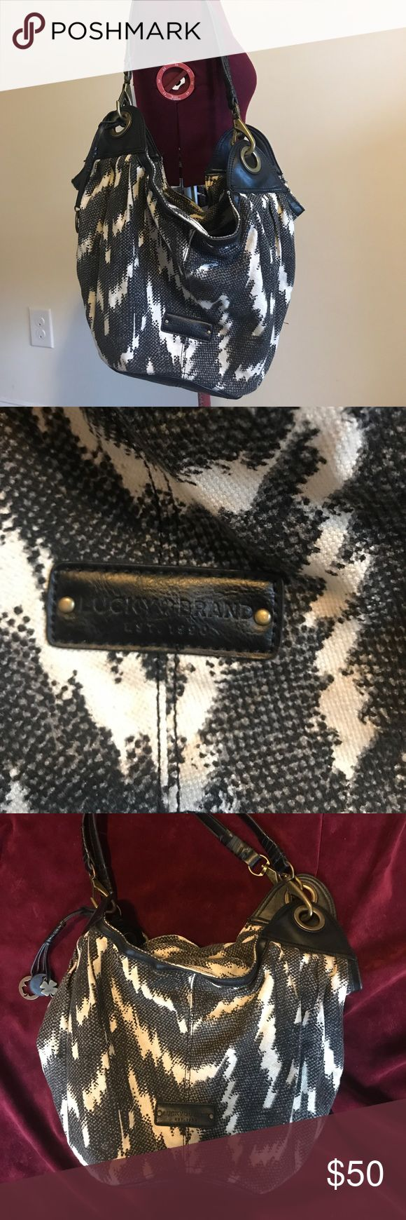Lucky Brand Purse Lucky Brand Purse. Preowned in good condition. The outside has no major wear snag or stains. The inside has some small stains but still in good condition. Lucky Brand Bags Shoulder Bags