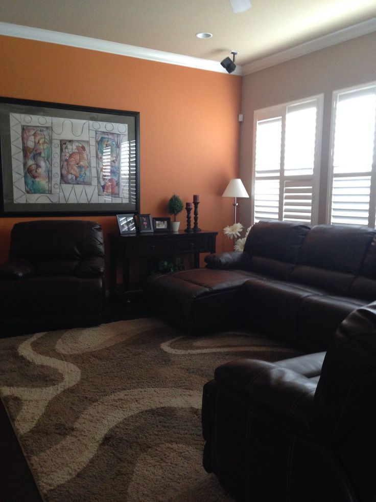 Family Room Decorated With Dark Wood Furniture And Orange Accent Wall Home