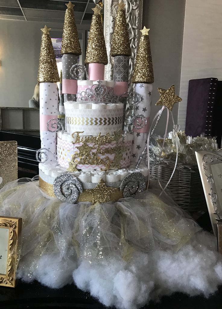 Castle Diaper Cake using receiving blankets for the towers!  Perfect centerpiece for baby shower, could make for boy or girl. Styrofoam Cones-Wood Dowels-Mod Podge-Glitter.
