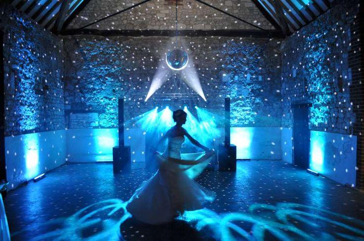 Blue uplighting, beam mounted mirror ball and intelligent dancefloor lighting... plus one beautiful bride!