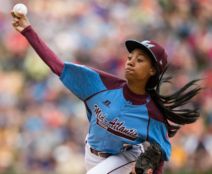 """15 August 2014 - Mo'ne Davis Dominates at Little League World Series - NYTimes.com. """"Davis pitched six innings, gave up a pair infield hits and struck out eight in a 4-0 victory over Nashville....With each out in the final inning, the cheers became louder, and when Davis struck out the final batter, becoming the first girl in Little League World Series history to earn a win, the crowd exploded."""