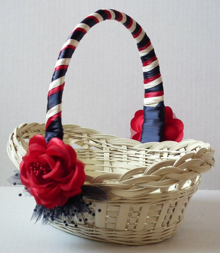 Flower girl basket - ivory with red, ivory, and navy blue satin ribbons - July 4th, americana, patriotic, or military wedding. $21.00, via Etsy.