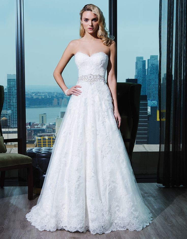 Corded lace ball gown embellished with a sweetheart neckline.