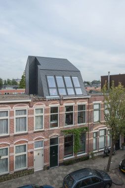 Roof extension - Bricks, slates and Velux skylight - architect: Flinterdiep - photography by Klaarlicht