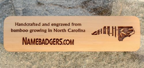 Bamboo Name Tags!!! This one is 2.75 x .75 and has a brown paint fill. Handcrafted and engraved from bamboo growing in North Carolina. Order online at NAMEBADGERS.COM