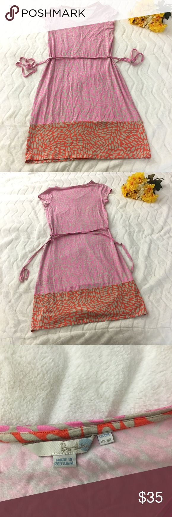 Boden Dress Gently used. Small hole near tag shown in photo. Pulling to the but area on back of dress, shown in photo. Boden Dresses