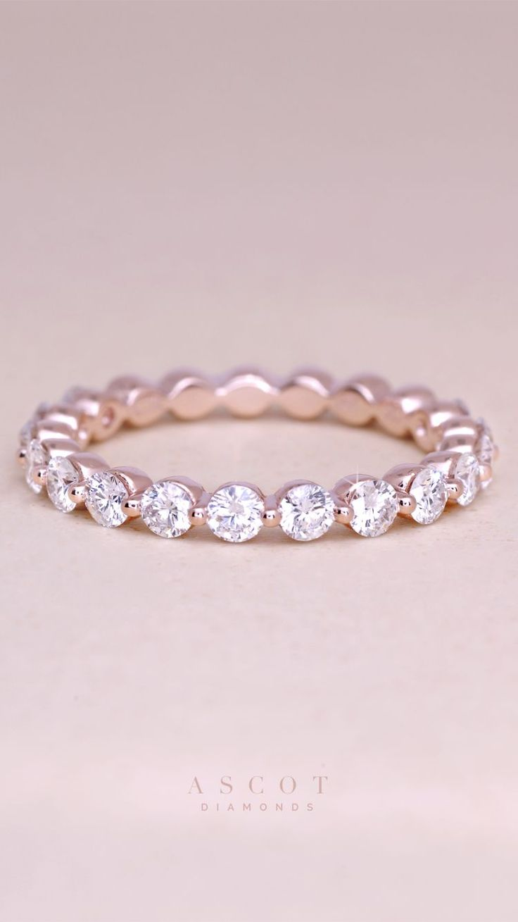 A custom rose gold thin diamond eternity wedding band, featuring fine white diamonds. Ascot Diamonds #ascotdiamonds