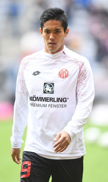 Yoshinori Muto of 1. FSV Mainz 05 warms up before the Bundesliga match between Bayern Muenchen and 1. FSV Mainz 05 at Allianz Arena on April 22, 2017 in Munich, Germany.