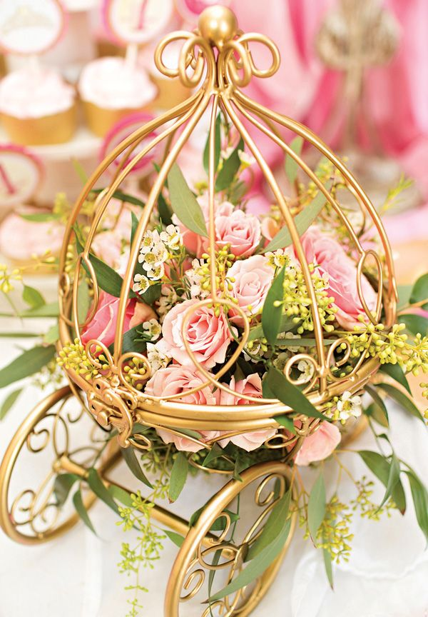 mini gold carriage with soft pink roses — would make beautiful centerpieces