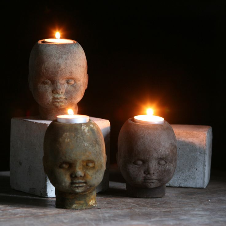 Doll Head candle holders - Find old dolls at a thrift store, paint with acrylic or spray paint (in black, brown & moss), cut hole out w/ exacto knife & add holder from the Dollar Tree.
