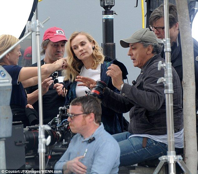 Entourage: The star was surrounded by assistants as she prepared to film the fashion house...