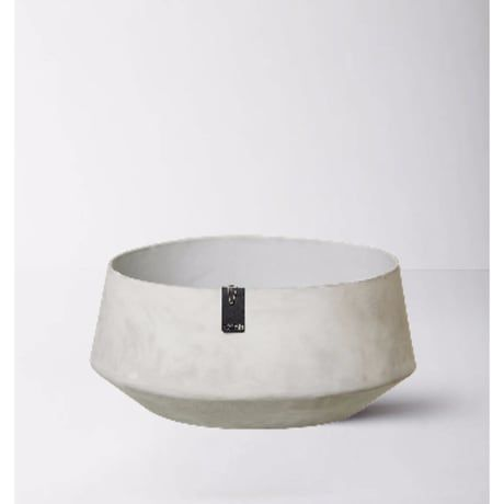 The Tokyo grey bowl is a beautiful part of our new unique 100% waterproof recycled paper pots and vase collection. The bowl has a matte 'concrete like' appearance. It is very tactile and feels like thick, silky smooth soft heavy duty cardboard to the touch. The inner is lined with layers of natural latex from the rubber tree. This bowl would make a truly delicate and elegant display piece for a coffee table or side table. These products are Danish in design and part of a unique fair-...