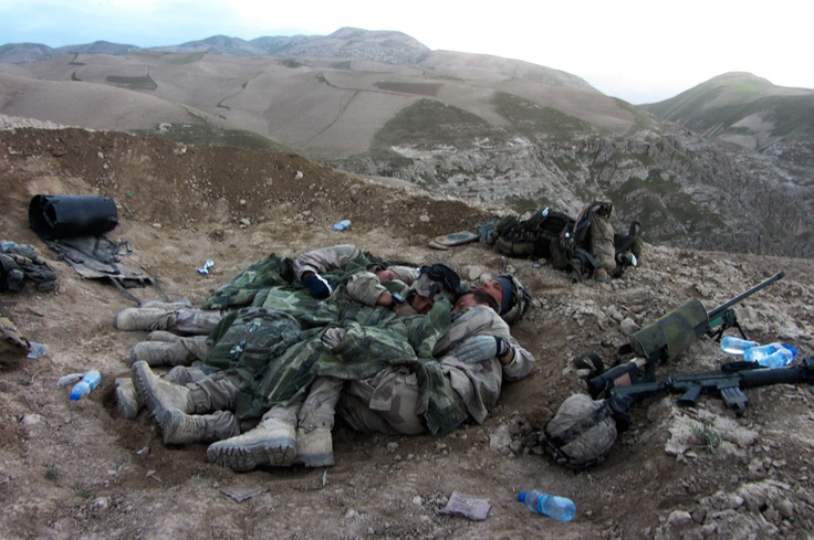 Swedish soldiers huddle together for warmth in Afghanistan. Photo credit: Försvarsmakten (I think that is the Swedish Armed Forces)